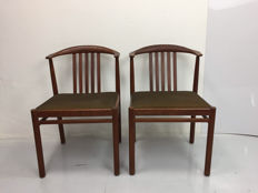 A pair of teak chairs