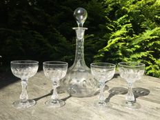 Facet cut decanter with four crystal glasses, early 20th century