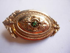 An old silver Victorian brooch with a small emerald