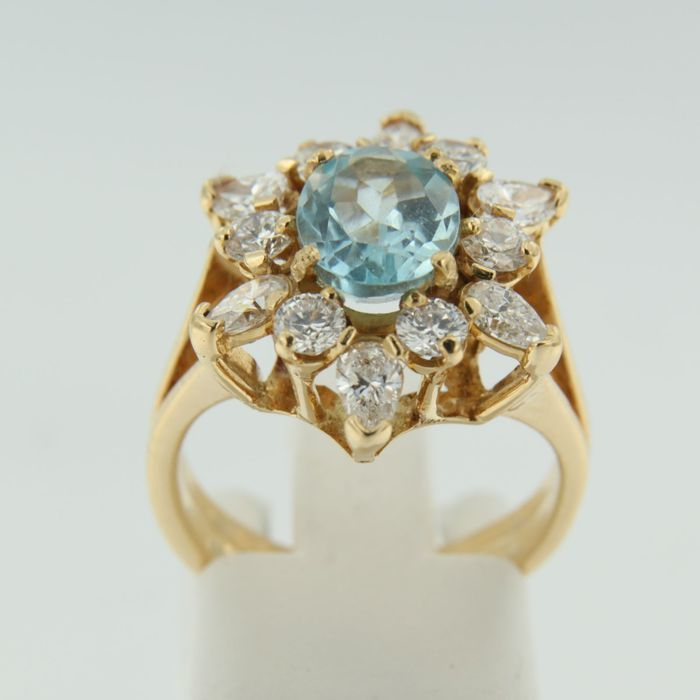 Yellow gold ring decorated by a rosette with brilliant diamonds and oval topaz, approx. 3.80 ct in total