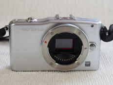 Olympus Pen Mini E-PM1 body with flash FL LM1 57