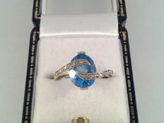 Vintage ring with a natural blue topaz and diamonds, ring size 16.5/52