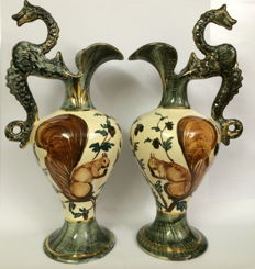 Two carafes with wire shaped handle