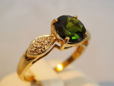 Golden ring with tourmaline 1.2 ct and 14 diamonds totalling 0.14 ct