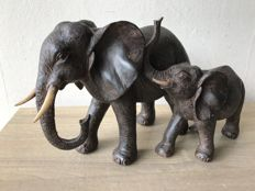 Sculpture of an elephant mother with young.