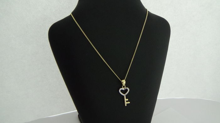 14 kt Gold Curb Link necklace with a key pendant, length 45.5 cm
