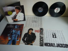 """Michael Jackson lot with the Michael Jackson History World Tour Book (15,5' x 12') in excellent state and 2 top albums of Michael: """"Bad""""and """"Thriller"""" Portuguese press with rare hype sticker, with the orig inlays"""