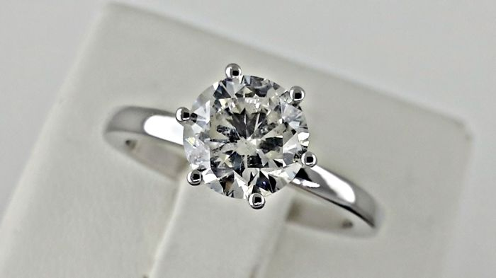 1.62 ct F/SI1  round diamond ring made of 18 kt white gold - size 7
