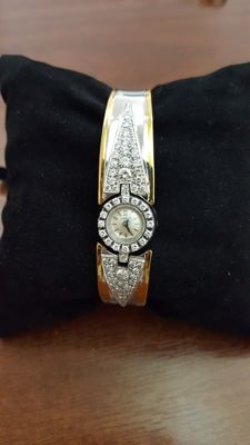 Gold bracelet watch with diamonds