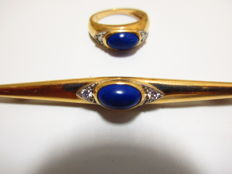 Van Cleef & Arpels - Brooch and ring set in 18 kt gold with lapis lazuli and diamonds.