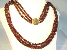 Victorian 3-row necklace consisting of faceted ruby glass strands
