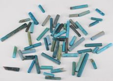 Ca. 50 blue faience beads.