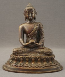 Bronze sculpture of a sitting Buddha - India/Nepal - second half 20th century