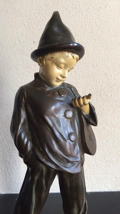 A bronze sculpture of a boy - early 20th century.
