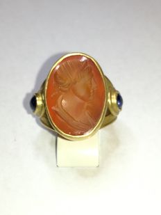 Gold ring with a cameo and sapphires
