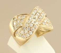 Yellow gold crossover ring of 14 kt, set with 63 brilliant cut diamonds of approx. 1.60 ct in total, ring size: 16.5 (52).