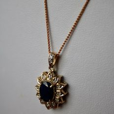 ca. 1960 9kt. Gold Pendant + Gold Chain with Sapphire approx. 7,8x6,4 mm approx. 1.55Ct. enchanted with 12 small old cut diamonds. Excellent for age.
