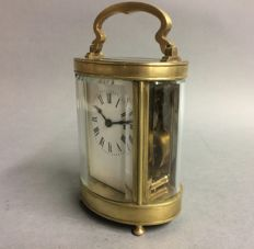 Oval antique brass carriage clock - period 1880/1890