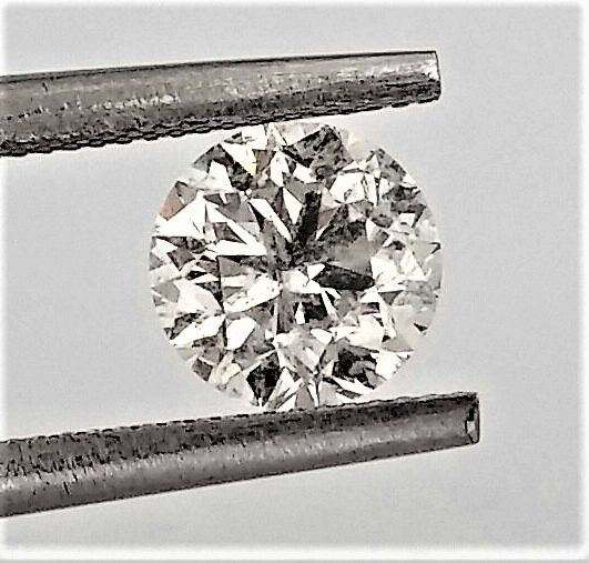 Round Brilliant Cut  - 1.03 carat  - E color  - SI2 clarity  - Natural Diamond  Comes With AIG Certificate + Laser Inscription On Girdle