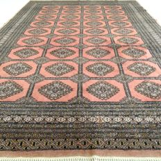 "BUKHARA – Pakistan – 259 x 181 cm – ""Finely knotted Persian rug in pink"" – Second half previous century."
