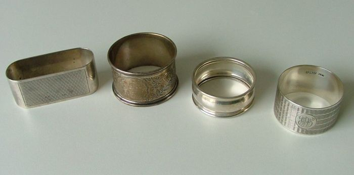 Four solid silver hallmarked English napkin rings. All circa 1930's