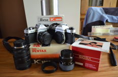 Beautiful Asahi Pentax K1000 camera with 3 lenses and a body of the same type with damage but working.