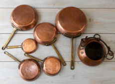 Antique set of  copper frying pans with tinned interior and one saucepan / cauldron