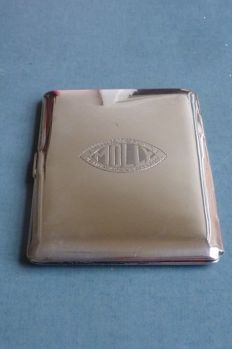 Silver cigarette case. ''Molly""