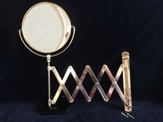 Rotating and extendable brass wall toilet mirror.
