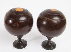 Two antique lawn bowls, wood