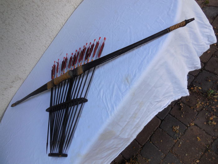 Old African Longbow of cane with wooden structure and 15 arrows with iron tips