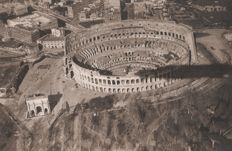 Year 1925 - Rome - the Colosseum with triumphal arch. photographed from an airship