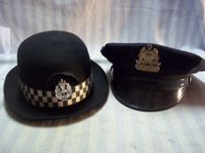 2 police caps, America and Scotland,