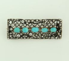 Gold with silver Victorian brooch with many old European and rose cut diamonds, approx. 1.00 ct and set with turquoise