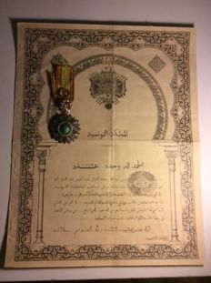 Officer of the order of Nichan Iftikar with his diploma