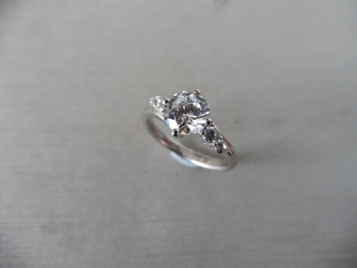 Platinum Diamond Set Solitaire Ring - 0.75ct / 0.09ct