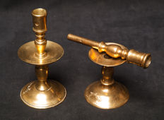 Two not fully identical 17th century Dutch brass candlesticks, of which one with removable top.