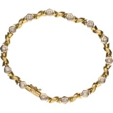 14 kt Bi-colour gold link bracelet whose white gold links are set with brilliant cut diamonds of approx. 0.03 ct each - length: 21 cm