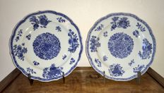 A set of blue/white porcelain dishes with floral and fruit decoration – China – 18th century