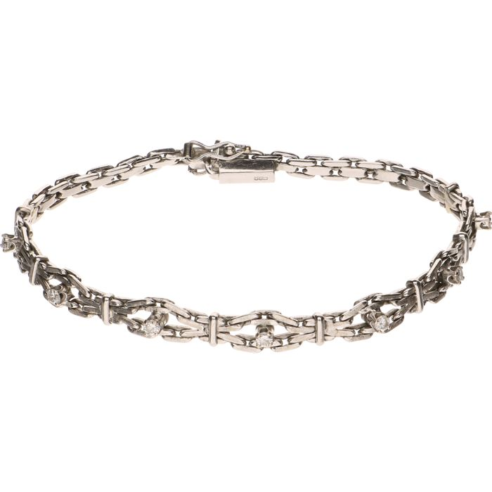 14 kt White gold bracelet set with seven brilliant cut diamonds of approx. 0.05 ct each - Length: 18 cm