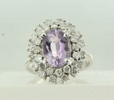 18 kt white gold entourage ring set with a central oval cut amethyst with a double row of entourage brilliant cut diamonds of approx. 1.50 ct in total, ring size 17.35 (54)