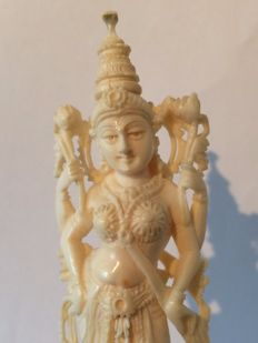 Very finely carved Ivory statue of Lakshmi, on a wooden stand - India - early 20th century