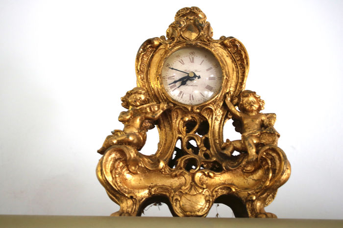 Antique mantelpiece/table clock adorned with inset gold decor, very fine