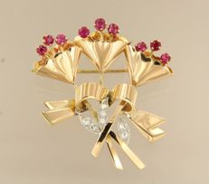 18 kt gold with platinum RETRO flower brooch set with rubies and Bolshevik cut diamonds