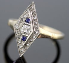 Art Deco 18K with Platinum rhombus ladies ring with diamonds (0.25 CT Total) and Blue Sapphire ( 0.04 CT Total ) circa. 1930