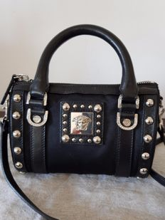 Versace – Mini handbag or shoulder bag with Medusa head and studs.