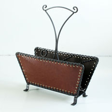 Manufacturer unknown – decoratively designed cast-iron and leather magazine/newspaper rack