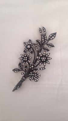 Old silver brooch.