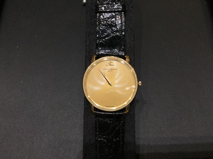 Baume & Mercier ultra-slim gold watch with black leather watchstrap and original buckle