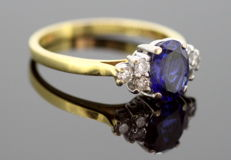 Vintage 18K ladies ring with blue sapphire (0.75 CT) and diamonds (0.12 ct total) London Circa.1970's